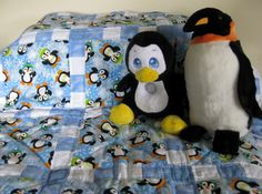 Penguins on Parade - a handmade baby quilt that will warm those chilly feathers http://uniquebabyquiltboutique.com/