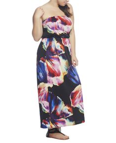 """Always feel like you're on vacation in this soft knit strapless maxi dress featuring a gorgeous, large tropical flower print. The skirt drapes beautifully while the thin smocked elastic waistband adds a defined silhouette and the tube top neckline's elastic band provides a great fit. Dress has stretch and the bodice is lined.  Model is 5'9"""" and wears a size 1X.   55"""" From bust to hem 95% Polyester / 5% ..."""