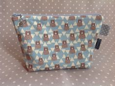 Teddy bears and triangles zipper bag made with wonderful fabric by japanese manufacturer. The teddies are light brown and triangles are off-white on light blue background. This zipper pouch is fully lined, the lining is light gray with small white polka dots. Size of this make up bag is approx. 24cm x 17cm x 7cm / 9.4in x 6.7in x 2.8in. This animal zippered clutch comes with a cute charm on the zipper. You can choose your charm between 4 different designs, please look at the options in...