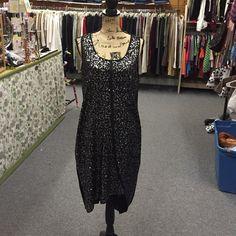 Lovely Donna Karan chemise Hi low and asymmetrical. Pewter sequin front. Classic black back. Sleeveless. Scoop neck Donna Karan Dresses Asymmetrical