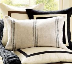 drop cloth pillows with painted stripes.