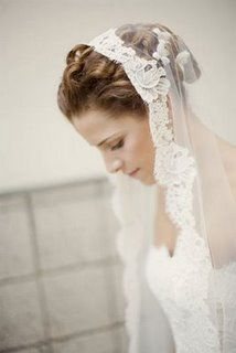 I either want a veil like this with a long train or a dress with a long train