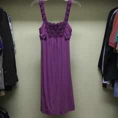 Brand New Elle size XS purple dress Brand New with Tags purple size Xs Elle dress with flower detail. Falls right at knee. Perfect for spring or summer! Elle Dresses Midi