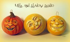 Painted gourd ornaments by Tammy Strum of Light and Shadow Studio. Two moons and a pumpkin.