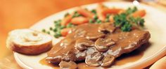 Enjoy beef steak with smooth mushroom gravy - a slow cooked elegant dinner!