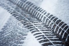 Fresh tire tracks in the snow Royalty Free Stock Photo