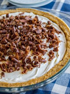 Classic French Silk Pie with Really Thick Graham Cracker Crust from The Food Charlatan! This French Silk Pie is the stuff of dreams! It is the classic recipe with a few enhancements: a really thick graham cracker crust (no pie shells here, please) and stabilized whipped cream so that your pie looks perfect even on day two. You must try it!! #french #frenchsilk #silk #pie #chocolate #chocolatepie #creampie #whippedcream #cream #creamy #chocolatecurls #grahamcracker #crust