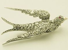 A fine, large and impressive antique 1.22 carat diamond, 14 carat yellow gold brooch modelled in the form of a swallow; part of the AC Silver antique jewellery / estate jewelry collection  http://www.acsilver.co.uk/shop/pc/1-22-ct-Diamond-and-14-ct-Yellow-Gold-Swallow-Brooch-Antique-Victorian-87p3628.htm