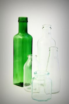 vvv Green bottle and the other by Maria Antonia Comparolo