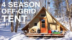 In this video, we give you a tour of a prospector-style, 4-season tent that is completely off-grid. The tent is built with two layers of weather-proof canvas stretched over a wooden frame and is equipped with a double combustion wood stove for heat, a solar panel to power 1 LED light, and a propane fridge to keep food cool during the summer months. The tent is separated into 4 quarters: dining room, kitchen, sleeping area, and woodstove/living room. There's also an outhouse, barbecue and…