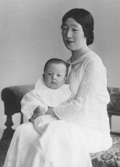 Late Empress Nagako embraces one-year-old Crown Prince Akihito, current emperor, at the Imperial Palace in Tokyo in this 1935 photo.