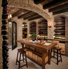 brick wall stone wall wooden beams farmhouse wooden table bar stools tiled floor arched wine storage of Lively Tuscan Interior Design: The Idea Serving You Best Homey Feeling