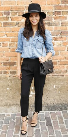 Jenna Dewan keeps her outfit simple with black trousers, a denim button up, Rag & Bone fedora, and accessorizes with a classic black Chanel bag.