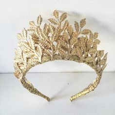 Gold leaf crown/tiara, made to measure depending on hair type/style. The crown pictured measures 3 inches high at the peak but sits on an angle backward making it not that height when wearing it (approx 2.5 inches when wearing)  Please contact me to discuss this further.  Can also be made in silver, rose gold, copper, white and baby/dusty pink  Thank you!! Ashlee Lauren Designs www.ashleelauren.com Instagram @ashleelaurendesigns