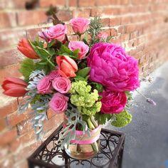 bright pink peony,coral tulips and green viburnum in twine jar @primalflower