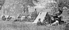 """Picket Station, Bull Run, Federal Encampment at Blackburn's Ford on Bull Run, July 4, 1862. Photo taken by Timothy H. O'Sullivan. The tent in the picture was known as a dog tent (as only dogs could sleep in it) and it was made of two """"shelter halves"""" which would  be carried by two soldiers and then buttoned together and supported by sticks when it came time to  bed down for the night. If it was a nice night, however, many soldiers just slept out in the open."""