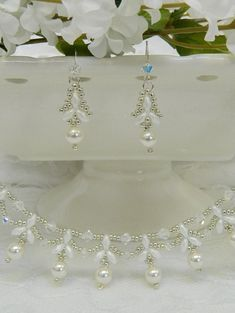 This set is so beautiful - dainty yet elegant and classic! I used Genuine Swarovski Crystals and Pearls & Opaque White Alabaster Pastel SuperDuos to form pearl drops that almost look like drops of flowers. I surrounded the drops with Galvanized Silver seed beads. It is finished with a