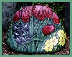 Black cat in tulips