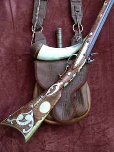 Flintlock Rifle with Bag, horn, and knife.