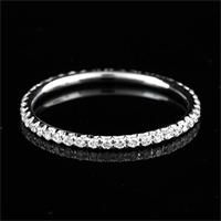Thin diamond band. Not this exact one but one like this.  No banding around the edges.  In different stones too for stacking.