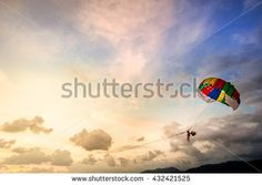 Colorful Parachute In Sunny Sunset Sky. Active Lifestyle - stock photo