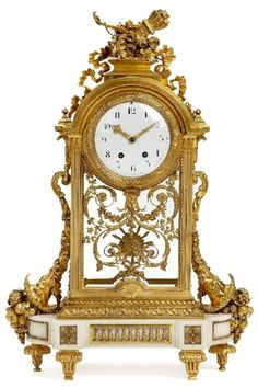 A large Louis XVI style ormolu and glass mantel clock. French, 19th Century.