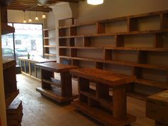 Wood shelving up the wall/pos counter reclaimed wood top