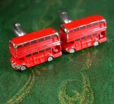 DOUBLE DECKER English Red Bus Cufflinks Vintage British Commuter Coach Decorative Novelty Men's Cuff Accessory. A perfect addition to a collection or a gift to that special someone. Maker: unknown Material: silvertone metal, red & black enamel Size: see photo Weight: medium/heavy Condition: In good vintage pre-owned condition. Lovely patina! Boxed for gift giving; gift wrapped on request. These are part of a MASSIVE estate collection of cufflinks and jewelry so be sure to check out our other…