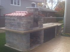 Chicago luxury designs outdoor kitchen, wood burning pizza oven, polished countertop