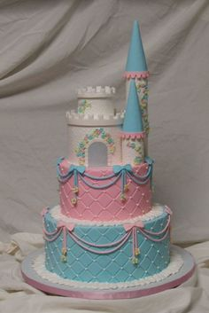 Princess Castle All Buttercream excpet the turrets are fondant covered paper towel rolls. Castle is cake, 5 and 2 inches. I had about 8...