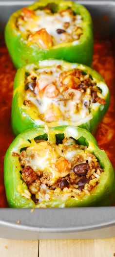 Mexican Stuffed Peppers – stuffed with Mexican ground beef, black beans, rice, tomatoes, cheese. Delicious! Gluten free.