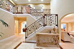 Image uploaded by Milana. Find images and videos about luxury, home and house on We Heart It - the app to get lost in what you love. Wrought Iron Staircase, Foyer Staircase, Stairs, Staircases, Stair Banister, Staircase Ideas, Railings, Property Design, Home Interior Design