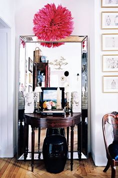 love the way they put a small table in front of a large mirror