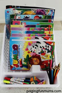 Here's a fantastic idea! Turn a dish rack into a fantastic colouring book caddy!