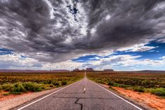 The Monument Road - When one arrives here, on this  stretch of road, on this infinite straight line of asphalt which leads the eye and the driver into an absolutely world famous landmark, it is literally impossible not to halt the car, step down and take a photo. Doesn't matter how many times one passes from here, he must stop. And when the sky is like this one, no excuses.