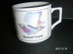 Place a bid on this:  APPLE MACINTOSH PORTABLE Coffee Cup for technology Collector - Computer MAC Desk Accessory MUG [MsFrugaLady on ebay, 7-Day Auction Listing, 1/13/2014]