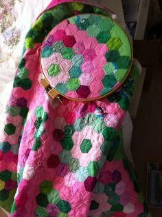Grandmother's Flower Garden quilt hand-quilting detail.