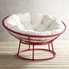 """Our iconic Papasan goes red for a bright pop of colorful fun. Handcrafted of all-weather wicker over a wrought iron frame, it plays outdoors as well as in.<span id=""""mini-upsell"""" data-launch=""""true"""" data-required=""""false"""" data-product=""""Cushions"""" data-masters=""""PV210-2:1""""></span>"""