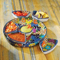 Show off your famous guacamole and salsa recipes- Entertain a dinner party at home with our Mexican molded ceramics. Talavera Salsera Serving Set | National Geographic Store
