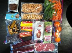packed on the plane:  - almond butter squeeze packs  - coconut butter squeeze packs  - cashews & macadamia nuts  - Larabars  - turkeys sticks (from Whole Foods)  - Paleonola  - dark chocolate  - snap peas & carrots  - Applegate Farms salami  - oranges