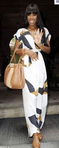 Who made Kelly Rowland's long print maxi dress and brown handbag? Dress – Diane von Furstenberg  Purse – Fendi