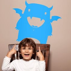 This monster wall graphic isn't as scary as it is hilarious with it's huge smile and pointy teeth! This funny...