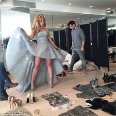 What a choice: Shakira is surrounded by shoes and glitzy outfits in this instagram snap sh...