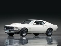 """1969 Boss 429 Mustang – Easily recognized by its massive hood scoop, the 1969 Ford Boss 429 Mustang is a true American muscle car. This mustang put the """"muscle"""" in muscle car; it's rated at 375 horsepower but functions closer to 600 horsepower. Ford Mustang Boss, Mustang Shelby, Mustang Cars, 1968 Mustang, 1969 Mustang Fastback, Shelby Gt500, Muscle Cars Vintage, Vintage Cars, Ford Mustangs"""