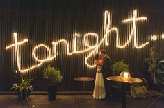 wedding photography new farm brisbane   Mirra Wedding under the tonight sign Photo by Boots Photography www.bootsphotography.com.au