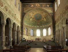 EARLY BYZANTINE: View of the decorated nave of St. Apollinare in Classe, c 549. Originally the nave walls and clerestory were also covered in mosaics (as can still be seen at Sant'Apollinare Nuovo) but these have all disappeared. The lower part of the wall and the spandrels of the arches are now decorated with frescoes and stucco of the 18th century. The fresco medallions depict bishops of Ravenna.
