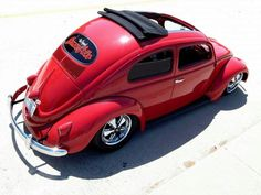 Pretty red VW bug with soft top sunroof