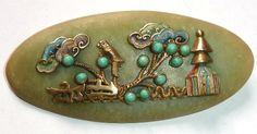 Max Neiger brooch in the Oriental style - on green galalith.  Photograph by Gillian Horsup.