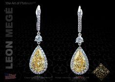 Fancy yellow diamond drop earrings by Leon Megé
