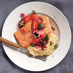 Creamy polenta and tangy vinaigrette complements this 20-minute dinner of Salmon with Polenta and Warm Tomato Vinaigrette.